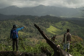 One of the main causes of deforestation in this region is land being cleared for cattle pasture. Two members of the monitoring team look across one such ranch prior to mapping it from the air.