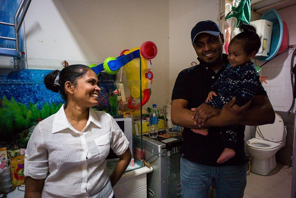 Supun, Nadeeka and one of their children.