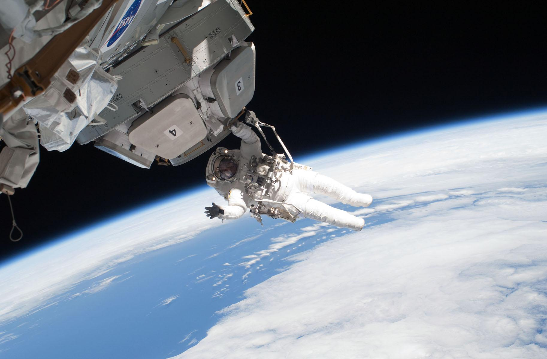 Astronaut on a space walk outside ISS