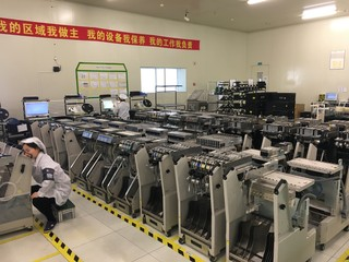 Rows of bots at CIG's Shanghai plant. Image: David Axe
