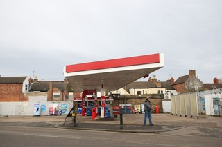 A solitary man at a petrol station in the middle of Oakham, Rutland
