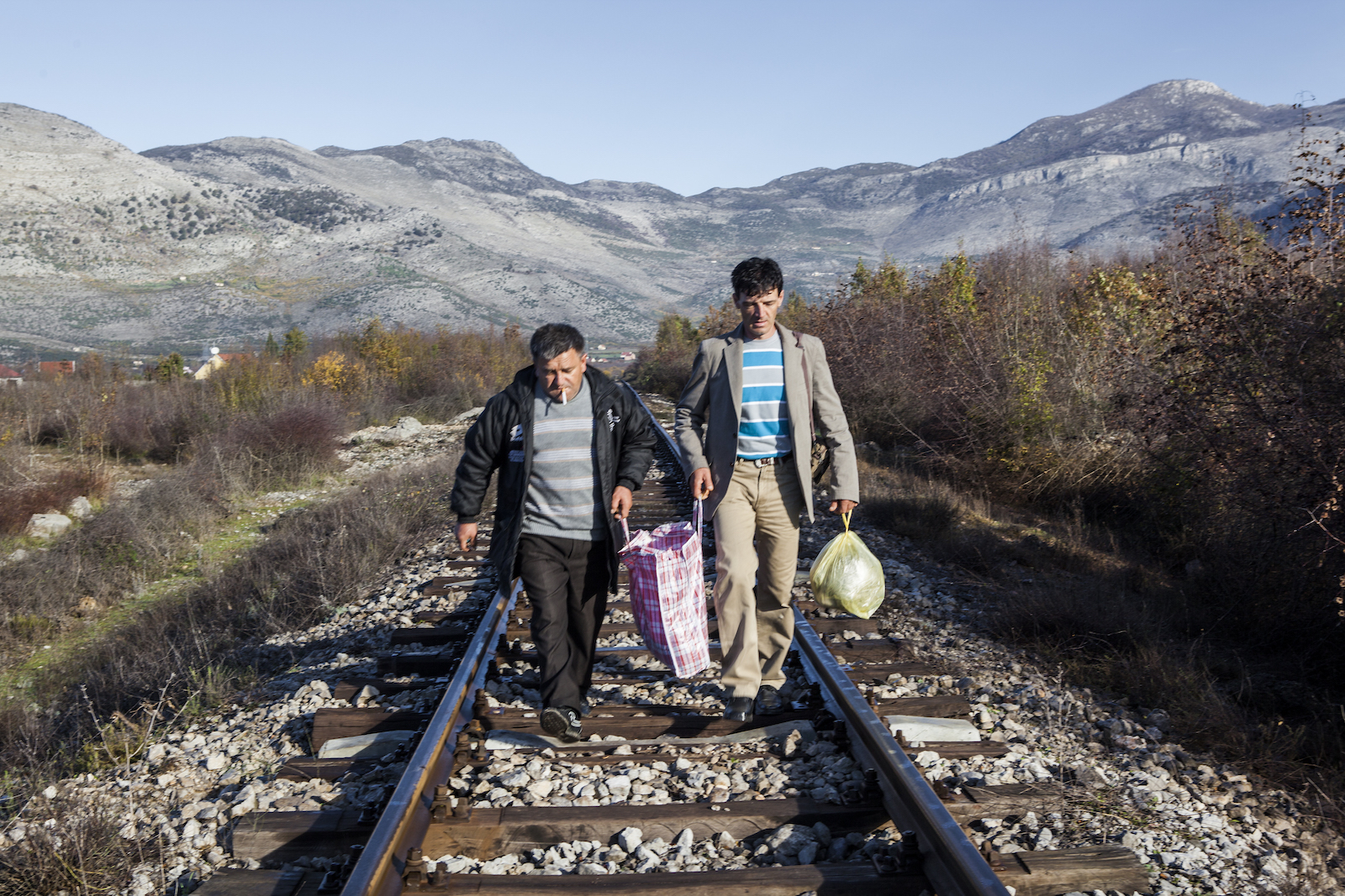 Serbian bachelor Milovan (right) walks along the railway near the border in Albania. Together with a friend, he's traveled from southern Serbia to Albania ...