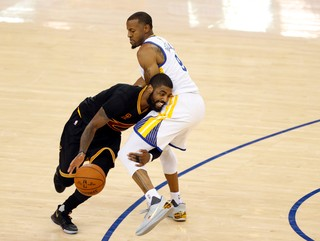 Andre Iguodala guards Kyrie Irving