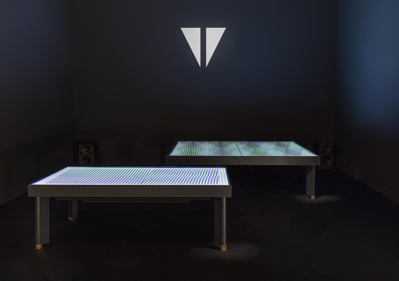 a futuristic table doubles as a digital art display creators