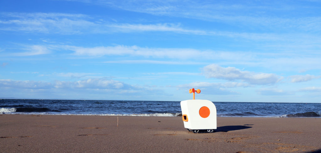 Watch This Adorable Robot Write Poems on the Beach