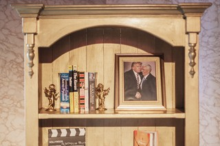 Other Details Were A Bookshelf Displaying Twitter For Dummies And Copy Of Barack Obamas Autobiography As Well Dart Board With Punctured Photo