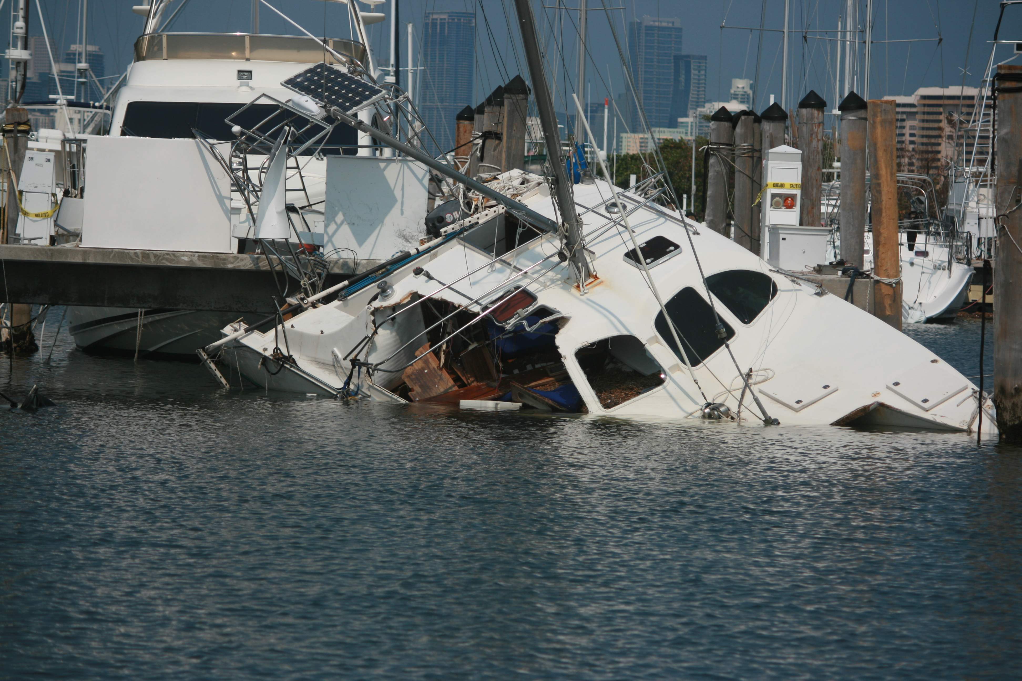 The guys cashing in on hurricane irma s boat destruction for Outboard motor salvage yard