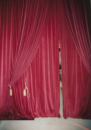 Red velvet curtains behind the scenes at London Fashion Week