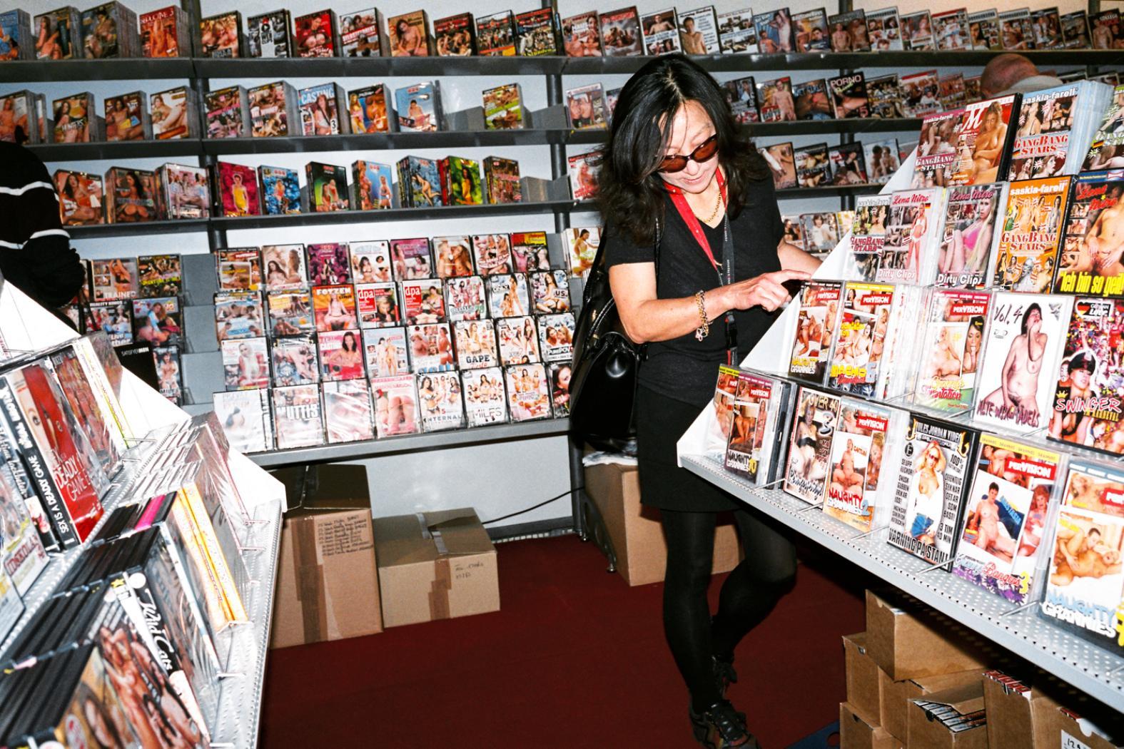 Mum browsing through the DVD shop.