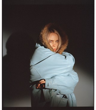 Billie Eilish in blue coat with fur hood