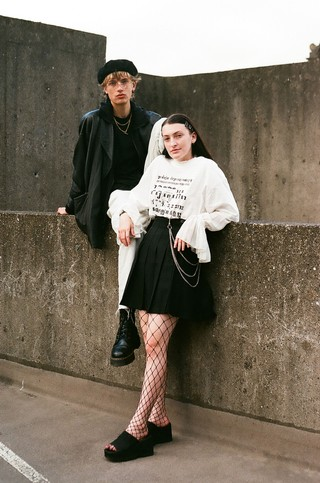 Newcastle youth photography: a couple standing and sitting on concrete walls