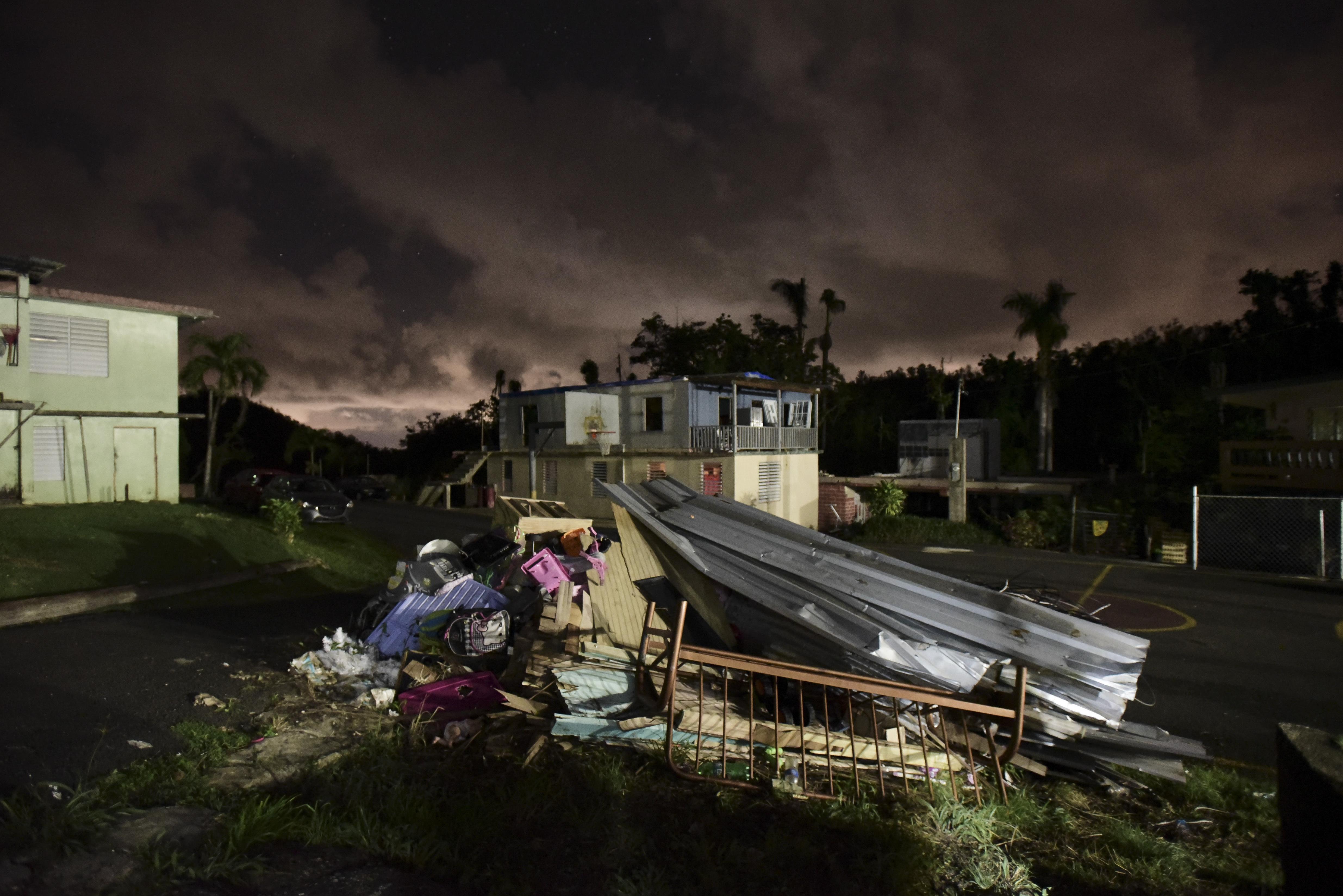Hurricane Maria's devastation follows Puerto Ricans into the New Year
