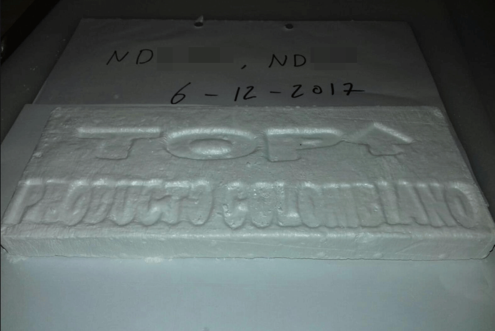 2f86c40e354 A block of cocaine stamped with