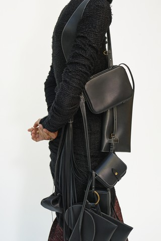 Phoebe Philo's final Céline collection: black handbags and a woollen coat