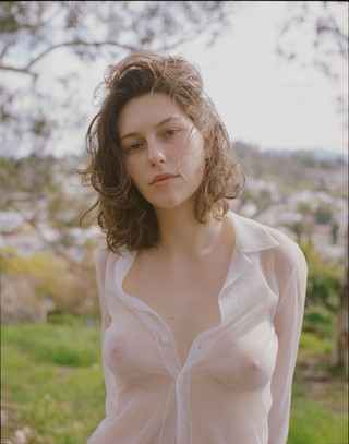 King Princess in a sheer shirt