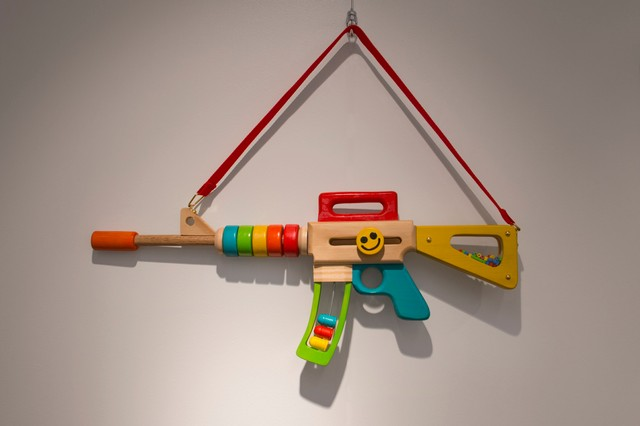 This Toy Assault Rifle for Toddlers Is a Twisted Take on