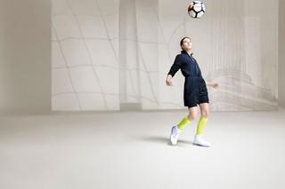 model kicking a football: Kim Jones for Nike