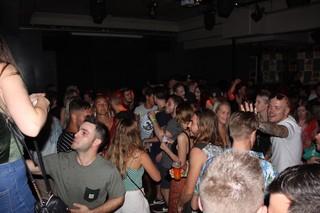 kissing guys in nightclubs