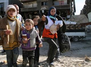 Menschen in einem Geflüchteten-Camp in Syrien