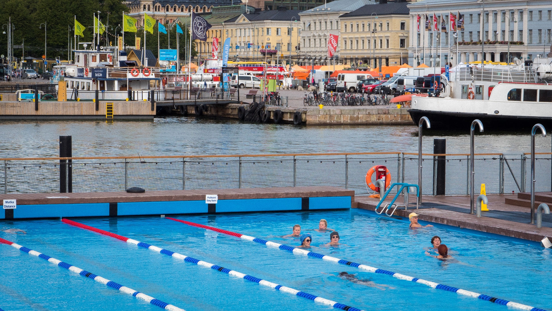 9cfe04f5e3a Helsinki locals swimming with one another in the centre of the city. Photo:  Joe Gilbert