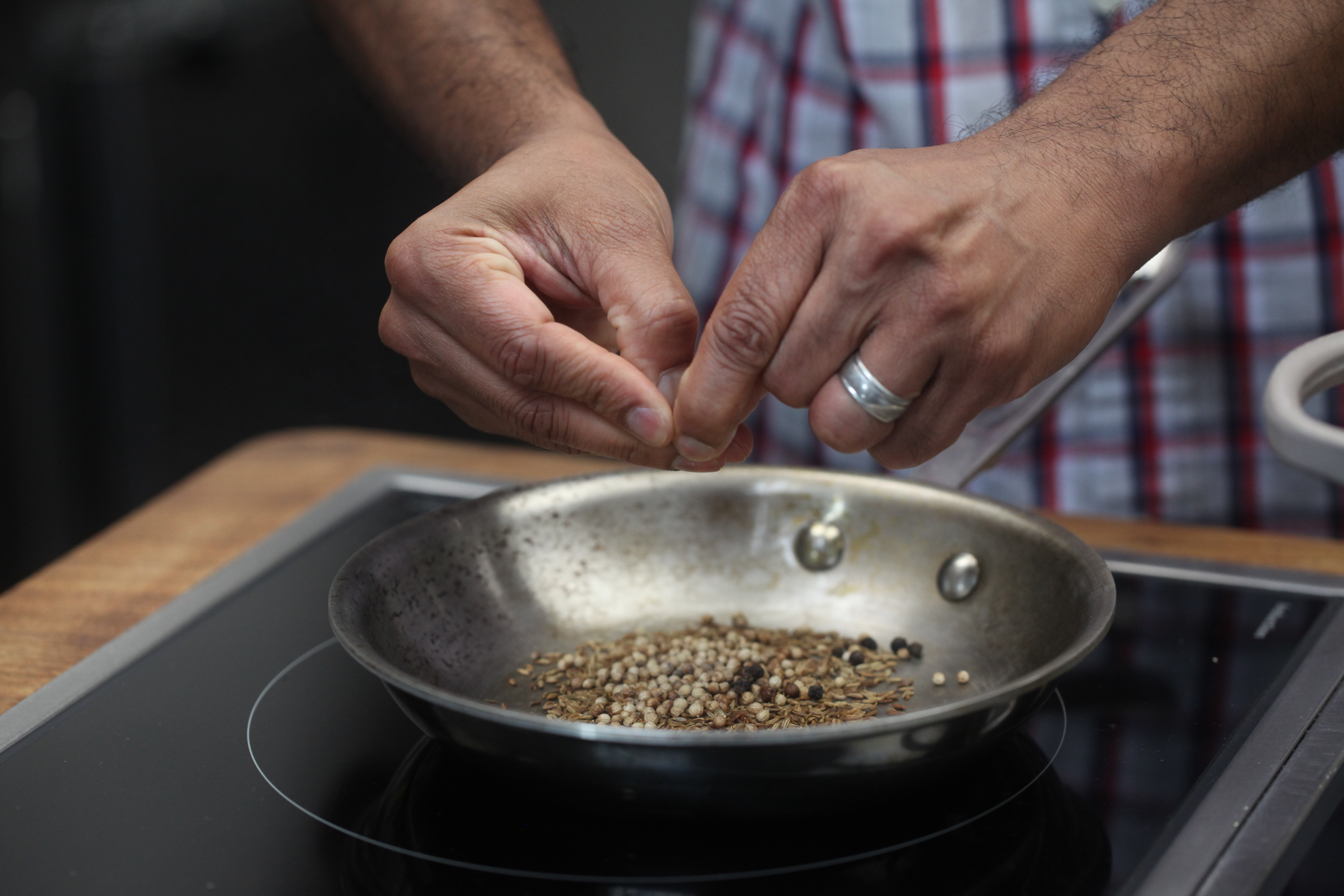 Hands prepping spices