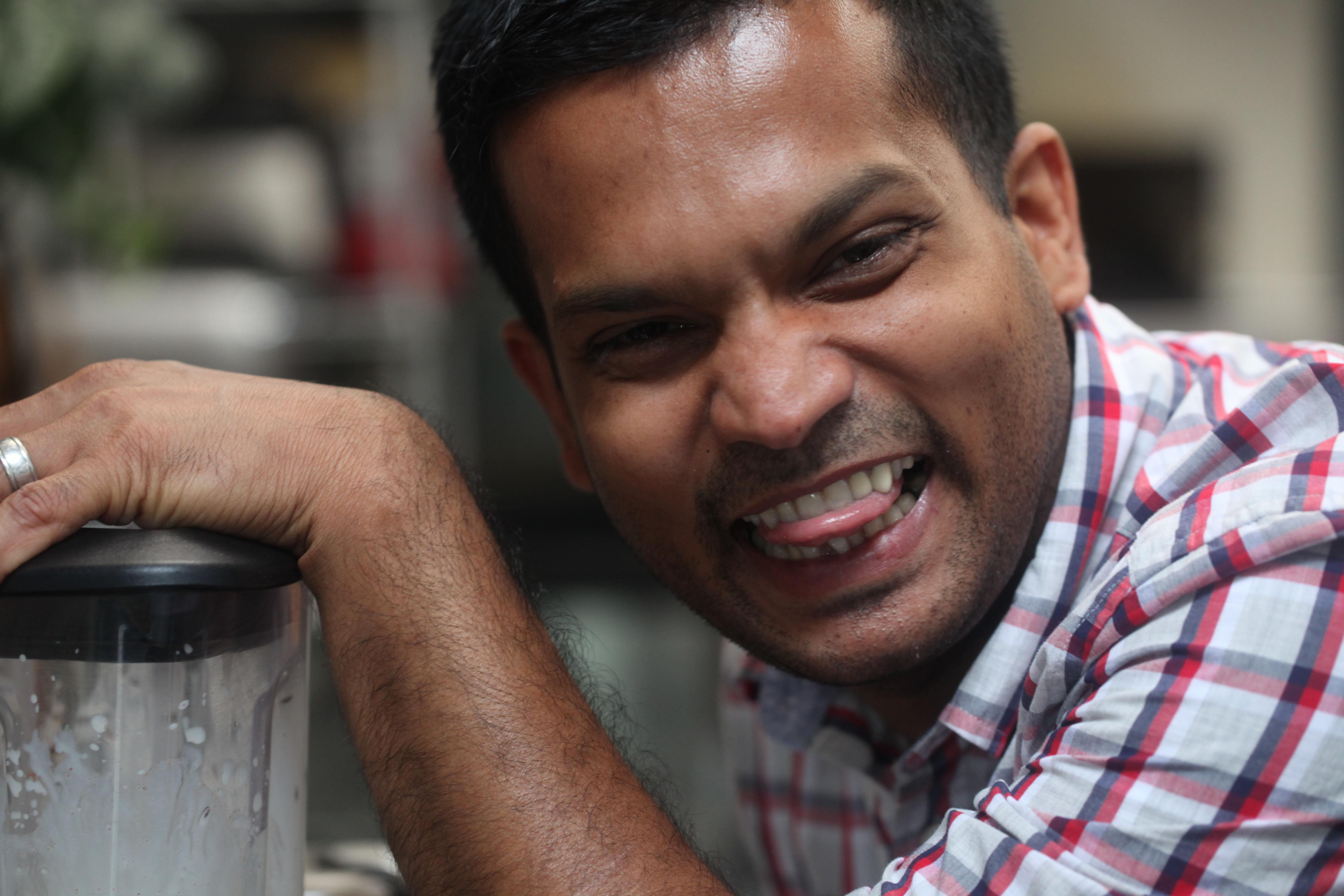 Man smirking with a blender