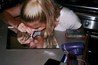 girl sniffing cocaine
