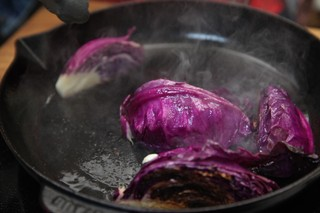 Cabbage wedges grilling in cast iron skillet