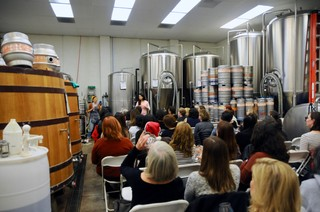 A group of women in a brewery.
