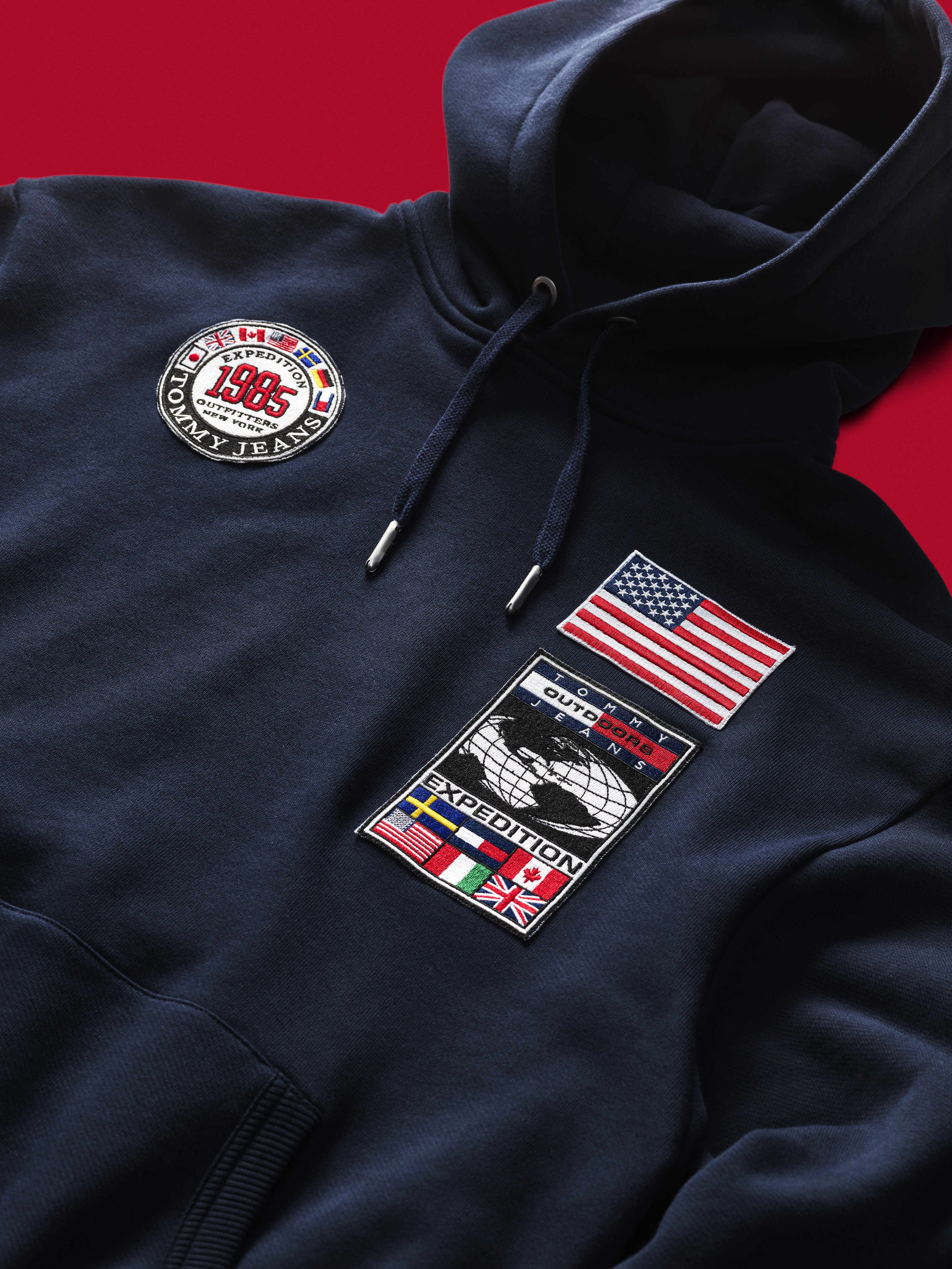 7a87284d6 1540214248001-TJM_EXPEDITION_HOODIE_DETAIL_01_004_red