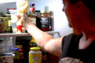 Naomi Pomeroy squirting kewpie mayo in her fridge