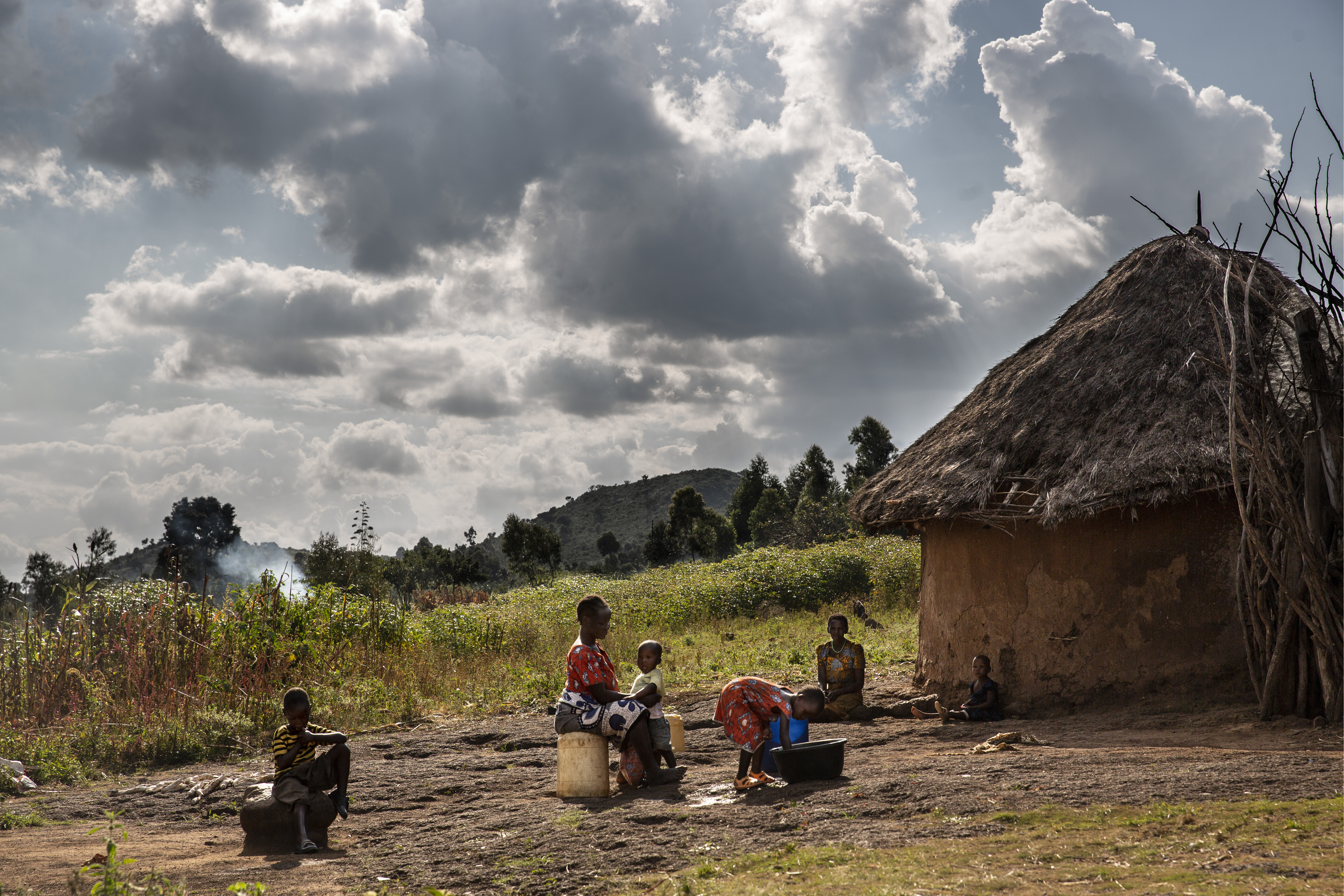 Women and children in front of home in Tanzania