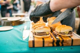 cheeseburgers on a cutting board.