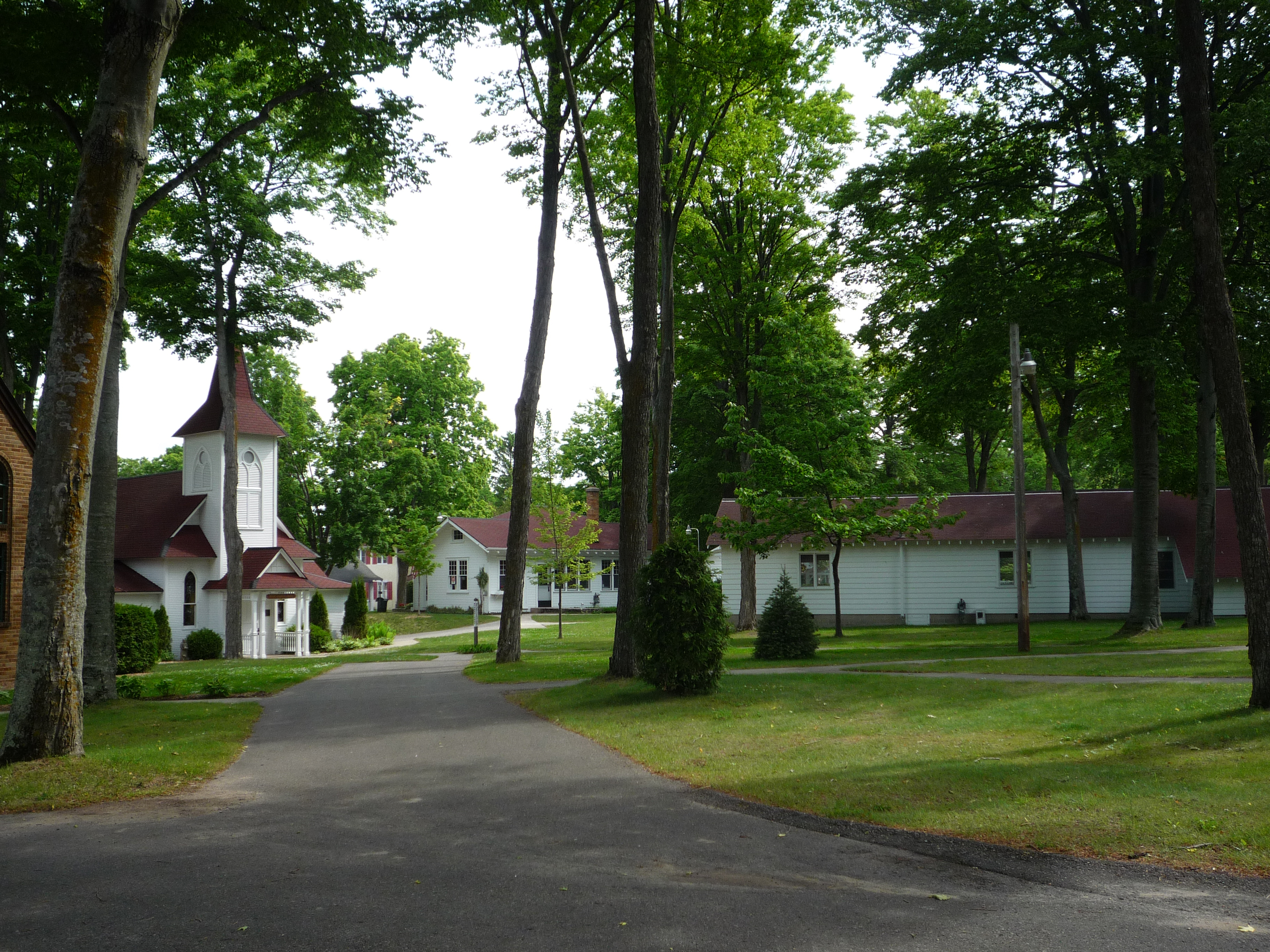 A quiet road runs past a church building in Bay View