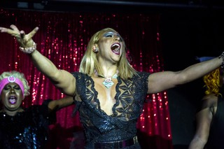 1540475480580-Josie_on_stage_in_drag_performing_2