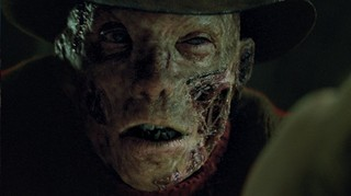 A close up of the reboot Freddy Krueger's burnt face