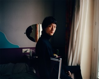Male model in his bedroom