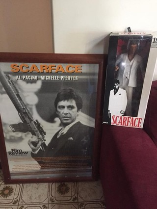 scarface poster and doll