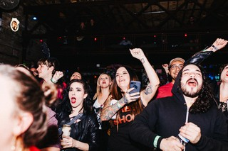 The crowd cheers and watches the MudQueens wrestling match at Reggies Rock Club, October 30, 2018.