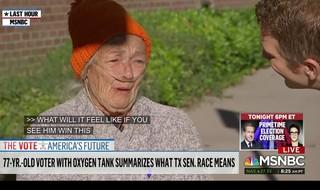 Elderly woman in orange hate is being interviewed.