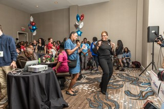 Two women broke out into dance at McBath's election results party Tuesday night.