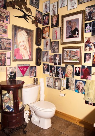A bathroom covered in photos of Dolly Parton