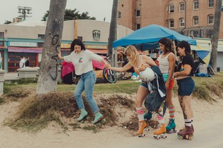 Moxi Skate girls help me down a sand hill