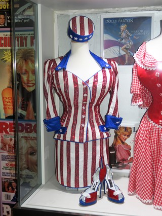 A red white and blue sequined outfit on a mannequin