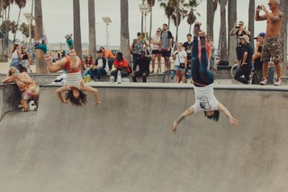 Michelle and Vanna doing a backflip in the bowl