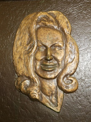 a bronze plaque of Dolly Parton's face