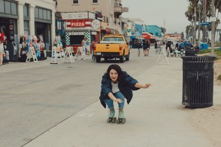 Me, bombing down the Venice Boardwalk