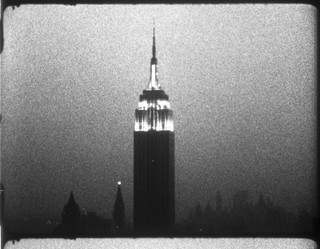 Andy Warhol (1928–1987), Empire, 1964. 16mm, b&w, silent; 8 hrs., 5 min. at 16 fps, 7 hrs., 11 min. at 18 fps © 2018 The Andy Warhol Museum, Pittsburgh, PA, a museum of Carnegie Institute. All rights reserved.