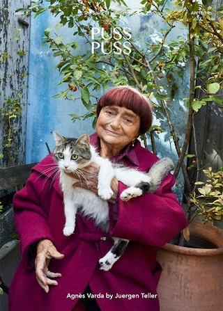 A woman holds a cat on the cover of PUSS PUSS