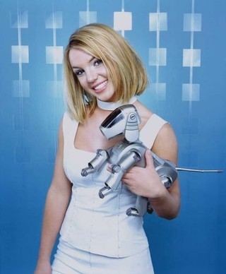 Britney Spears with a Sony Aibo robot dog: y2k aesthetic